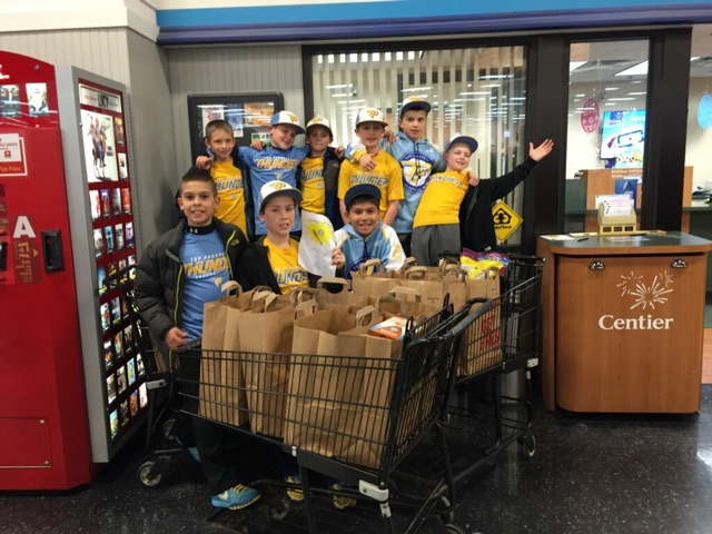 Local youth baseball team helps feed the hungry